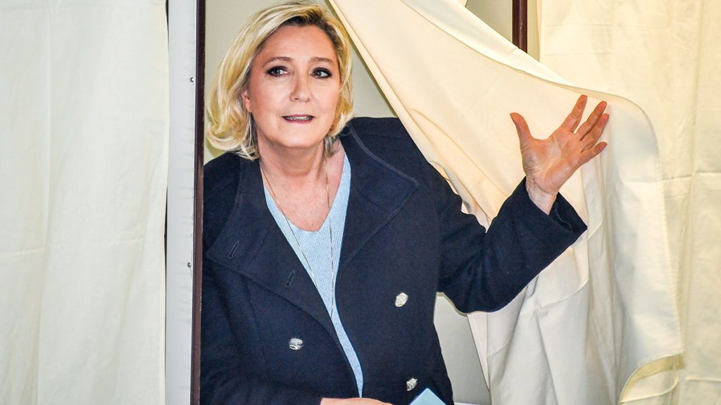 French far-right Rassemblement National (RN) President and member of Parliament Marine Le Pen leaves the polling booth to cast her vote for the European Parliament elections in Henin-Beaumont, on May 26, 2019. (Photo by DENIS CHARLET / AFP)