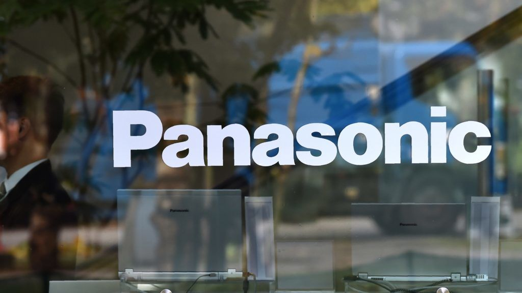 The logo of Japan's Panasonic Corp. is displayed in the window of their building in Tokyo on November 1, 2016. - Tokyo shares opened lower on November 1, weighed down by lower oil prices and jitters over the US presidential elections, while Panasonic tumbled after it slashed its annual profit forecast. (Photo by KAZUHIRO NOGI / AFP)