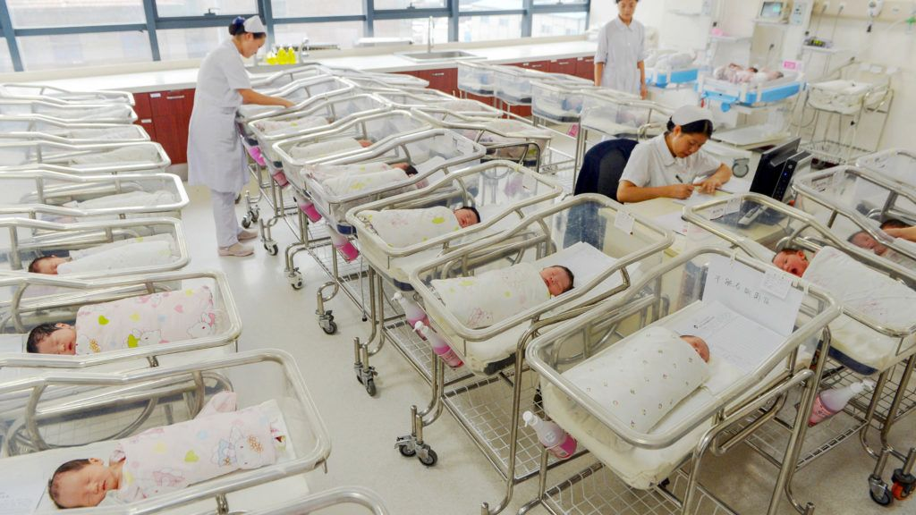 """--FILE--Chinese nurses attend newborn infants at a hospital in Lanzhou city, northwest China's Gansu province, 31 August 2016.China's decision to allow all couples to have two children instead of one has resulted in birth rates rising to the highest level since 2000, a government official said. New births in the world's most populous nation reached 17.86 million in 2016, up around 1.4 million compared to the 2011-2015 average, said Yang Wenzhuang of the National Health and Family Planning Commission. """"While the total number of women of childbearing age fell by 5 million, the number of births increased significantly, showing that the family planning policy adjustments were extremely timely and extremely effective,"""" he told reporters on Sunday (22 January 2017). Worried about the costs of supporting an increasingly ageing population, China issued new guidelines in late 2015 allowing all parents to have two children."""
