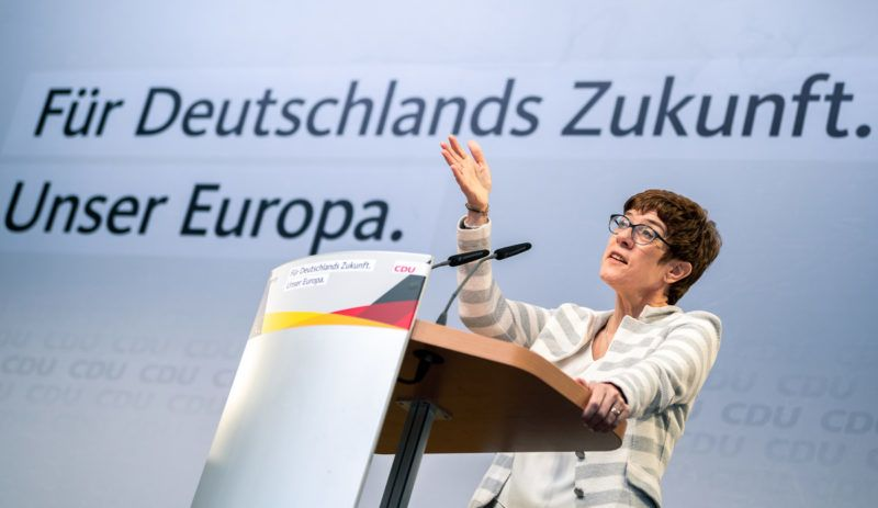 """21 May 2019, Bremen: Annegret Kramp-Karrenbauer, Federal Chairwoman of the CDU, is standing with raised hands on a stage under the title """"For Germany's Future - Our Europe"""" during the election campaign event of the CDU Bremen. Photo: Mohssen Assanimoghaddam/dpa"""
