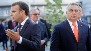 Hungary's Prime Minister Viktor Orban (R) and France's President Emmanuel Macron arrive at the Mozarteum University to attend a plenary session part of the EU Informal Summit of Heads of State or Government in Salzburg, Austria, on September 20, 2018. (Photo by GEORG HOCHMUTH / APA / AFP) / Austria OUT
