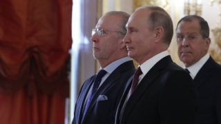 Russian President Vladimir Putin (C) receives a diplomatic credential from newly appointed Spanish Ambassador to Russia Fernando Valderrama Pareja (L), as Russian Foreign Minister Sergei Lavrov stands nearby, during a ceremony at the Kremlin in Moscow on October 11, 2018. (Photo by Sergei Karpukhin / POOL / AFP)