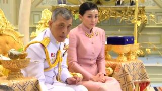 """This screengrab from Thai TV Pool video taken on May 1, 2019 shows a ceremony in which Thailand's King Maha Vajiralongkorn """"legally married"""" Suthida Vajiralongkorn na Ayudhya in Bangkok. - Thailand announced on May 1, 2019 that King Maha Vajiralongkorn's long-time consort had become his fourth wife, bestowed with the title Queen Suthida -- a surprise move just days before his coronation. (Photo by Thai TV Pool / THAI TV POOL / AFP)"""