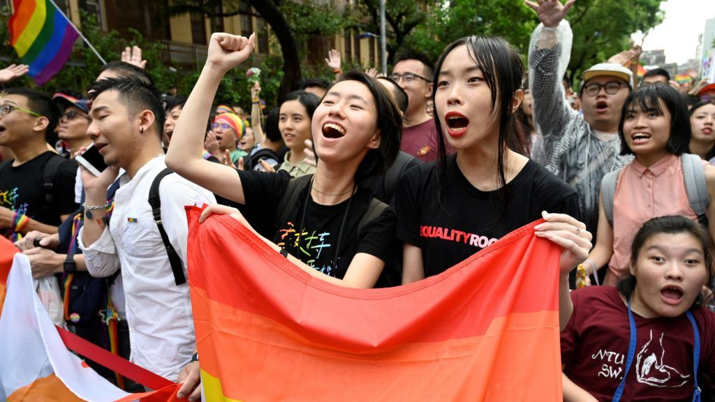 Supporters of same-sex marriage celebrate outside the parliament in Taipei on May 17, 2019. - Taiwan's parliament legalised same-sex marriage on May 17, 2019, in a landmark first for Asia as the government survived a last-minute attempt by conservatives to pass watered-down legislation. (Photo by Sam YEH / AFP)