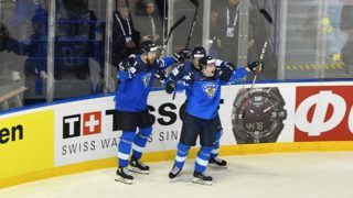 Finland's forward Sakari Manninen (C) celebrate after scoring during the IIHF Men's Ice Hockey World Championships quarter-final match between Finland and Sweden on May 23, 2019 at the Steel Arena in Kosice, Slovakia. (Photo by JOE KLAMAR / AFP)