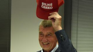 """Czech Prime Minister Andrej Babis, founder and leader of the populist ANO party, poses with a cap reading """"Strong Czechia"""" after the European elections on May 26, 2019 in Prague. (Photo by Michal CIZEK / AFP)"""