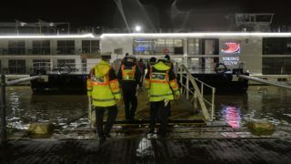 Hungarian police officers walk onto a Viking Cruises Sigyn hotel-boat as they investigate an accident on the banks of Danube River in downtown Budapest on May 30, 2019. - Seven South Korean tourists were killed and 19 missing after a pleasure boat capsized on the Danube in the Hungarian capital, the foreign ministry said on May 30, 2019. A total of 33 South Koreans were onboard and seven have been rescued, with a rescue operation underway for the missing 19, it said, adding the boat capsized after a collision on May 29 with a cruise ship, without elaborating further. (Photo by GERGELY BESENYEI / AFP)