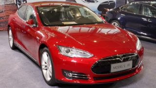 """--FILE--A Tesla Model S 85 electric car is displayed during an auto show in Nanjing city, east Chinas Jiangsu province, 3 October 2014.     Tesla Motors Inc. began taking online orders for its Model S electric car in China yesterday (20 October 2014), joining General Motors Co. and Volkswagen AG in selling vehicles through Alibaba Group Holding Ltd. (BABA)'s online shopping mall. Buyers can place a 50,000-yuan ($8,200) deposit for the electric car through Alibaba's Tmall.com, according to Tesla China spokeswoman Peggy Yang. ''Tmall offers us an opportunity to reach out to general customers, """" she said by telephone. Tesla, led by billionaire Elon Musk, began deliveries of the Model S to the world's largest auto market in April. The automaker is seeking to cut down the time required to ramp up its sales by selling directly through the Web rather than set up a network of dealerships across the country."""