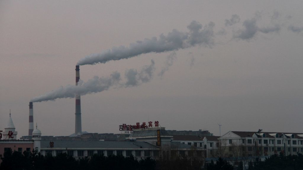 --FILE--Smoke is discharged from chimneys at a plant in heavy smog in Weihai city, east China's Shandong province, 12 December 2016.  Activity in China's manufacturing sector likely grew at a slightly slower pace in October as the government began a major crackdown on air pollution, ordering many steel mills, smelters and factories to curtail or halt production over the winter, a Reuters poll showed. But official readings are still expected to show a healthy rate of expansion for manufacturing overall, buoyed by a continuing government infrastructure spree and strong global demand for China's exports heading into the peak year-end shopping season. The data will give global investors their first look at business conditions in China at the start of the fourth quarter, with the war on smog adding to uncertainty and coinciding with early signs of a slowdown in the world's second-largest economy.