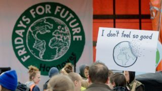 03 May 2019, Lower Saxony, Hanover: Students hold up signs during a Fridays for Future demonstration. The students protest against the current climate policy. Photo: Julian Stratenschulte/dpa