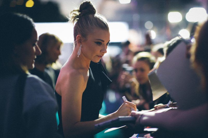 ZURICH, SWITZERLAND - OCTOBER 05: (EDITORS NOTE: Image was altered with digital filters.) Natalie Dormer writes autographs as she attends the 'Picnic at Hanging Rock' premiere during the 14th Zurich Film Festival at Festival Centre on October 05, 2018 in Zurich, Switzerland. (Photo by Andreas Rentz/Getty Images)