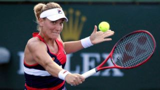 INDIAN WELLS, CA - MARCH 07: Timea Babos of Hungary hits a backhand against Yulia Putintseva of Kazakhstan during the ladies singles first round match on day four of the BNP Paribas Open on March 7, 2019 in Indian Wells, California. (Photo by Kevork Djansezian/Getty Images)