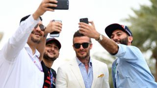 BAHRAIN, BAHRAIN - MARCH 31: David Beckham poses for a selfie with fans before the F1 Grand Prix of Bahrain at Bahrain International Circuit on March 31, 2019 in Bahrain, Bahrain. (Photo by Clive Mason/Getty Images)