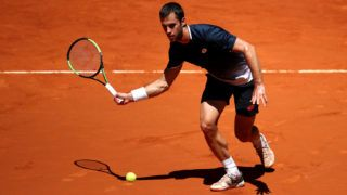 MADRID, SPAIN - MAY 09: Laslo Djere of Serbia returns thin his match against Marin Cilic of Croatia during day six of the Mutua Madrid Open at La Caja Magica on May 09, 2019 in Madrid, Spain. (Photo by Alex Pantling/Getty Images)