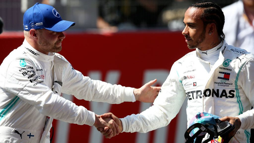 BARCELONA, SPAIN - MAY 11: Pole position qualifier Valtteri Bottas of Finland and Mercedes GP shakes hands with second place qualifier Lewis Hamilton of Great Britain and Mercedes GP in parc ferme during qualifying for the F1 Grand Prix of Spain at Circuit de Barcelona-Catalunya on May 11, 2019 in Barcelona, Spain. (Photo by Charles Coates/Getty Images)