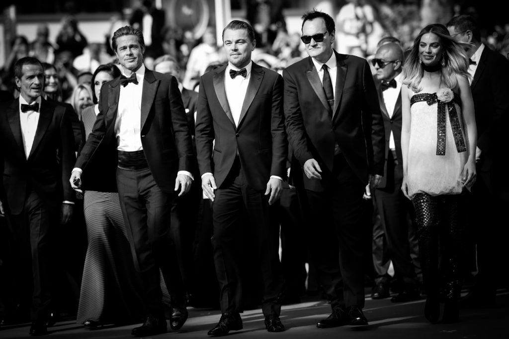 """CANNES, FRANCE - MAY 21:  (EDITORS NOTE: Image has been converted to black and white)  Brad Pitt, Leonardo DiCaprio and Quentin Tarantino attend the screening of """"Once Upon A Time In Hollywood"""" during the 72nd annual Cannes Film Festival on May 21, 2019 in Cannes, France. (Photo by Andreas Rentz/Getty Images)"""