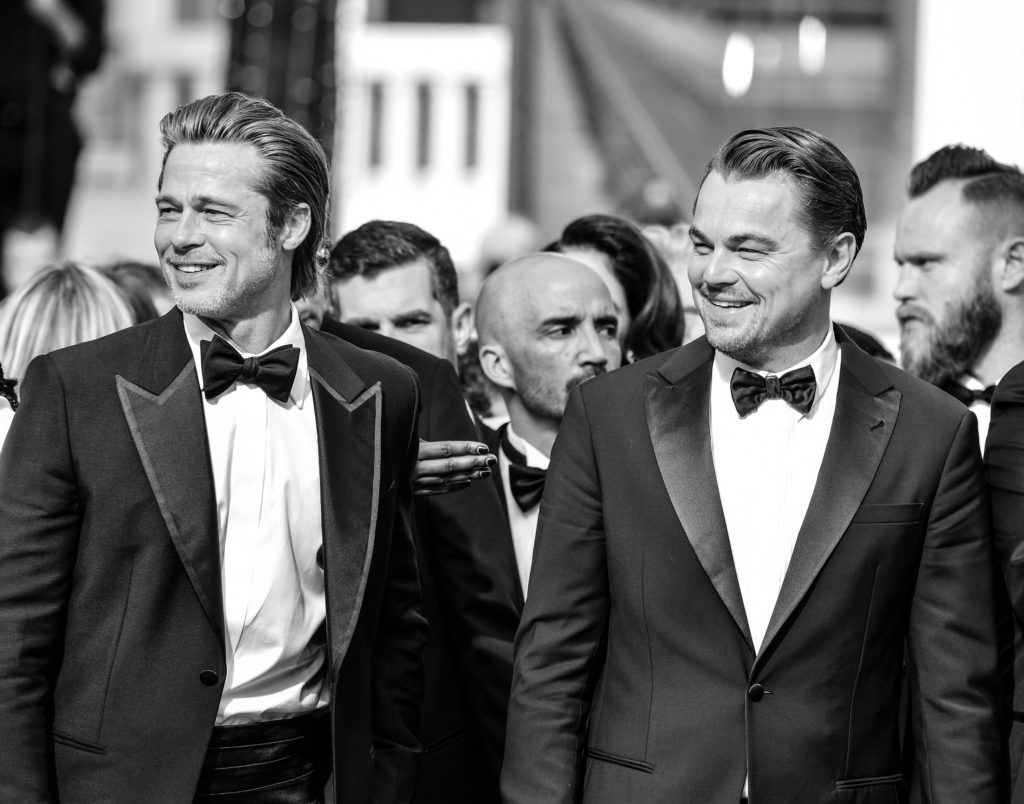 """CANNES, FRANCE - MAY 21:(Editors Note: Image has been converted to Black & White) Brad Pitt and Leonardo DiCaprio attend the screening of """"Once Upon A Time In Hollywood"""" during the 72nd annual Cannes Film Festival on May 21, 2019 in Cannes, France. (Photo by George Pimentel/WireImage)"""