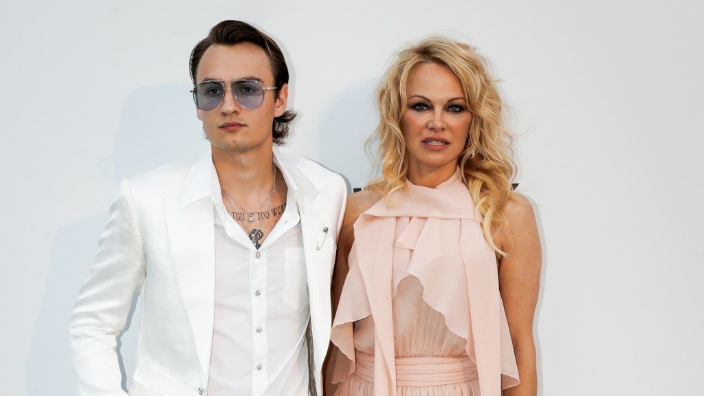 CAP D'ANTIBES, FRANCE - MAY 23: Brandon Thomas Lee (L) and Pamela Anderson attend the amfAR Cannes Gala 2019 at the Hotel du Cap-Eden-Roc on May 23, 2019 in Cap d'Antibes, France. (Photo by David M. Benett/Dave Benett/Getty Images)