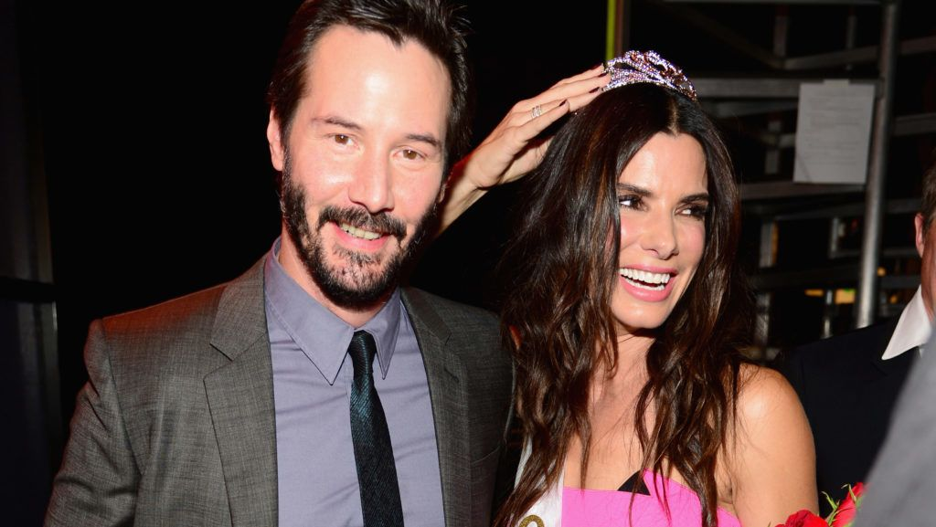 """CULVER CITY, CA - JUNE 07:  Actors Keanu Reeves (L) and  Sandra Bullock speak onstage at Spike TV's """"Guys Choice 2014"""" at Sony Pictures Studios on June 7, 2014 in Culver City, California.  (Photo by Frazer Harrison/Getty Images for Spike TV)"""