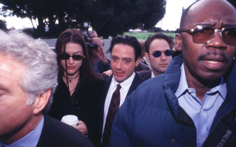 317855 08: FILE PHOTO: Actor Robert Downey Jr., center, with his ex-wife Deborah Falconer at his side, is flanked by his attorneys, security and the media as he arrives at the Malibu Courthouse to face drug charges December 8, 1997 in Malibu, CA. Three years later, at about the same time of the month, a source close to the actor said December 5, 2000 that Robert Downey Jr. faces a court hearing later this month on felony drug charges and was hospitalized over the weekend for treatment of depression. (Photo by John T. Barr/Liaison)