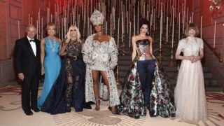 NEW YORK, NY - MAY 07:  Stephen A. Schwarzman,  Christine Schwarzman, 2018 Met Gala Host, Donatella Versace, 2018 Met Gala Host, Rihanna, 2018 Met Gala Host, Amal Clooney and Met Gala Chairperson, Anna Wintour attend the Heavenly Bodies: Fashion & The Catholic Imagination Costume Institute Gala at The Metropolitan Museum of Art on May 7, 2018 in New York City.  (Photo by Kevin Mazur/MG18/Getty Images for The Met Museum/Vogue)