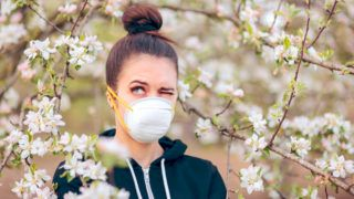 Funny girl trying to protect herself from pollen and allergens