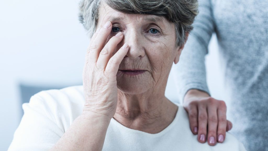 Image of sad woman suffering from senility