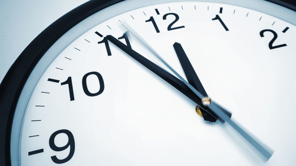 Closeup shot of a classic wall clock with motion effect.  ideal for websites and magazines layouts