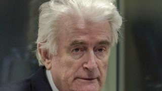 Former Bosnian Serb leader Radovan Karadzic sits in the court room of the International Residual Mechanism for Criminal Tribunals in The Hague, Netherlands, on March 20, 2019 as he waits to hear the final judgement on his role in the bloody conflict that tore his country apart a quarter of a century ago. - Karadzic was notorious for his role in the 1995 Srebrenica massacre where more than 8,000 Muslim men and boys were slaughtered in the worst bloodletting on European soil since World War II. In one of the last remaining cases from the break-up of Yugoslavia, UN judges in The Hague will rule on his appeal against his 2016 conviction for genocide and war crimes, and his 40-year jail sentence. (Photo by Peter Dejong / POOL / AFP)