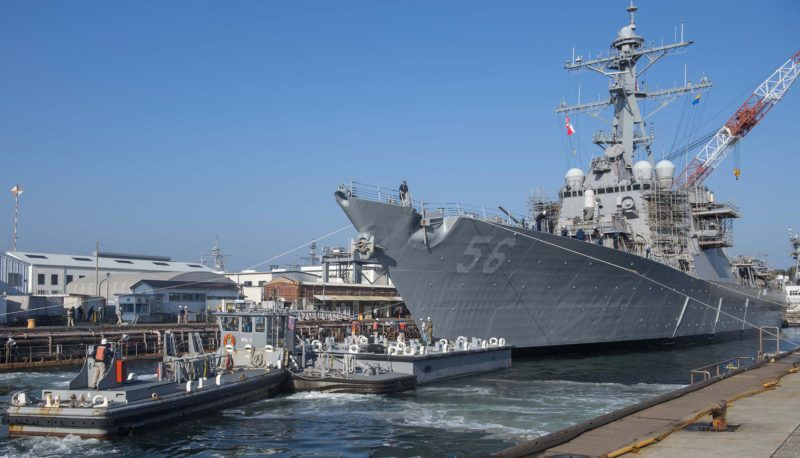 """(FILES) In this file handout photo released by the US Navy on November 27, 2018 the Arleigh Burke-class guided missile destroyer USS John S. McCain (DDG 56) prepares to depart from a dry dock at Fleet Activities Yokosuka, Japan. - The White House requested a Navy ship bearing the name of US President Donald Trump's late rival senator John McCain be kept """"out of sight"""" during a recent presidential trip to Japan, the Wall Street Journal reported on May 29, 2019. """"USS John McCain needs to be out of sight,"""" a Navy official instructed in an email about the visit, according to the newspaper. (Photo by Tyra WATSON / US NAVY / AFP) / RESTRICTED TO EDITORIAL USE - MANDATORY CREDIT """"AFP PHOTO / US NAVY / MASS COMMUNICATION SPECIALIST 3RD CLASS TYRA WATSON """" - NO MARKETING NO ADVERTISING CAMPAIGNS - DISTRIBUTED AS A SERVICE TO CLIENTS"""