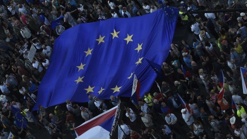 People display the European Union flag during a rally demanding the resignation of Czech Prime Minister Andrej Babis on June 4, 2019 on the Venceslas Square in Prague. (Photo by Michal Cizek / AFP)