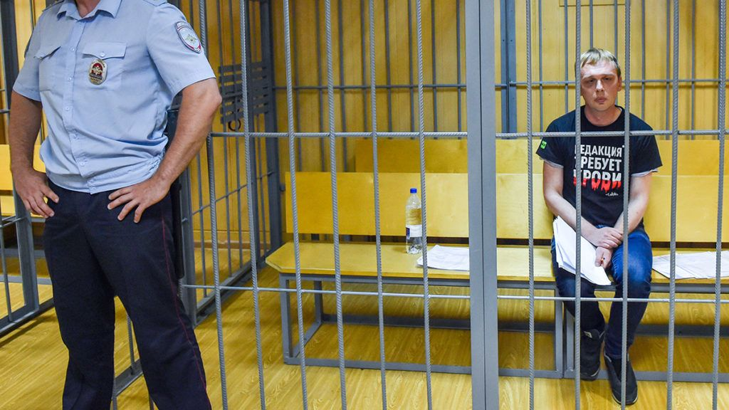 Russian investigative journalist Ivan Golunov, charged with attempted drug-dealing, sits inside a defendants' cage during a hearing at a court in Moscow on June 8, 2019. (Photo by Vasily MAXIMOV / AFP)