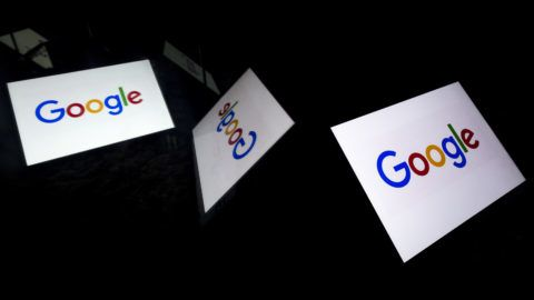 """(FILES)This file illustration picture shows the US  multinational technology and Internet-related services company Google logo displayed on a tablet in Paris on February 18, 2019. - Google took in some $4.7 billion in revenue in 2018 from """"crawling and scraping"""" news websites without paying publishers, according to a media industry-sponsored study released on June 10, 2019. The study by the News Media Alliance underscores industry arguments about Google and other online giants harming traditional news organizations by dominating the internet news ecosystem and ad revenues generated through it. (Photo by Lionel BONAVENTURE / AFP)"""