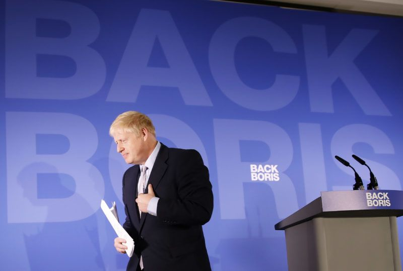 """Conservative MP Boris Johnson leaves the podium during his Conservative Party leadership campaign launch in London on June 12, 2019. - Boris Johnson launched his campaign Wednesday to replace Theresa May as Britain's next leader, as lawmakers moved to stop him and other hardliners from delivering a """"no deal"""" Brexit. (Photo by Tolga AKMEN / AFP)"""