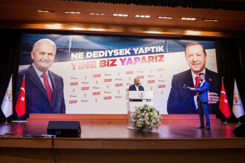Binali Yildirim (C) mayoral candidate of the ruling AK Party delivers a speech at his party's Istanbul headquarters in Istanbul, on June 23, 2019. - The newly elected mayor of Istanbul, Ekrem Imamoglu of the secular opposition CHP, said on June 23, 2019, he was ready to work with Turkish President Recep Tayyip Erdogan to solve Istanbul's problems after winning a decisive victory over Erdogan's candidate Yildirim (AKP) in the re-run mayoral election after they were annulled by the Election authorities that result after Erdogan claimed irregularities in the counting. (Photo by GURCAN OZTURK / AFP)