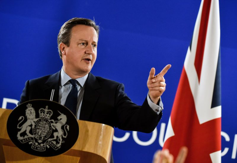 """British Prime minister David Cameron gestures as he delivers a speech during a press conference during a European Union summit on June 28, 2016 at the EU headquarters in Brussels. - Britain's exit from the European Union may erode the bloc's leadership role in fighting climate change and stymie crucial efforts to set more ambitious targets for cutting greenhouse gases, officials and experts said on June 28. European leaders meeting in Brussels pressured British Prime Minister David Cameron Tuesday to launch the two-year withdrawal process """"as soon as possible"""", but the embattled premier has vowed he will leave that task to a successor to be named on September 9. (Photo by PHILIPPE HUGUEN / AFP)"""