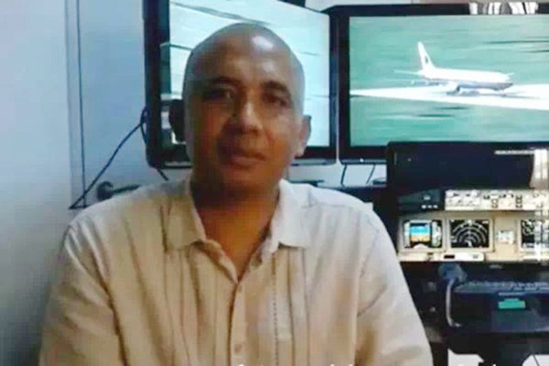 A file photo of Malaysia Airlines fight MH370 pilot Zaharie Ahmad Shah. Police searched the luxury home of pilot Zaharie Ahmad Shah on Saturday after it was revealed the missing Malaysia Airlines flight MH370 turned back from its scheduled flight path over the South China Sea and flew for more than seven hours with its communication tracking device disabled. Police were examining an elaborate flight simulator taken from the home of pilot Zaharie Ahmad Shah.