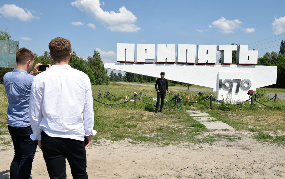 5914482 12.06.2019 Visitors take pictures in the abandoned city of Pripyat, near the Chernobyl nuclear power plant, Ukraine. The Chernobyl miniseries by HBO, which depicts aftermath of the world's worst nuclear accident occurred on April 26, 1986 at the Chernobyl Nuclear Power Plant, including the clean-up operation and subsequent inquiry, drives boom in tourists travelling to see the site of nuclear disaster. Stringer / Sputnik