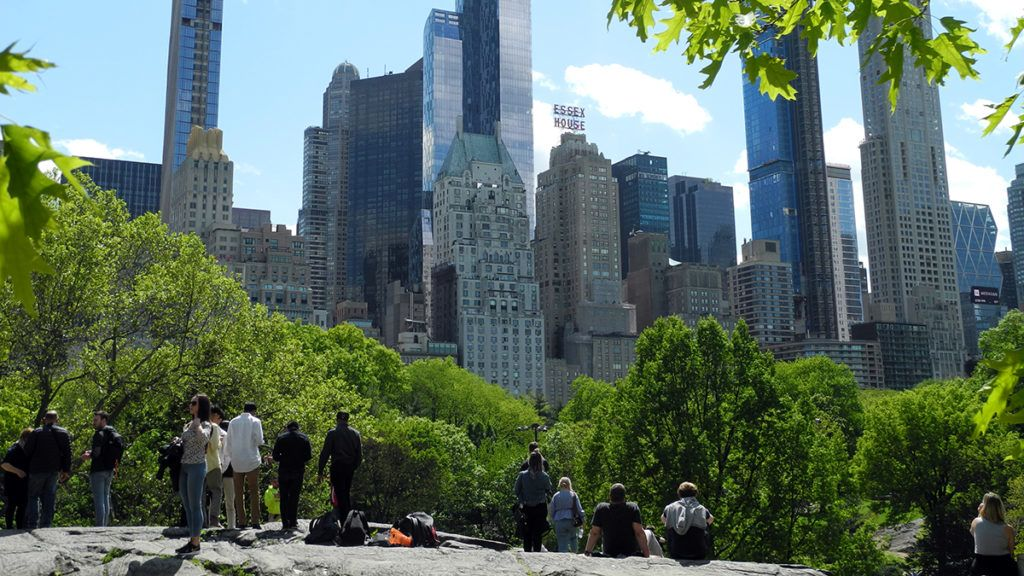 """15 May 2019, US, New York: People in Central Park are looking at huge skyscrapers. New skyscrapers are springing up in New York. Some use loopholes to offer their wealthy customers a fantastic view. But there is resistance. (to dpa """"million penthouses in 400 meters height: Who owns New York's skyline?"""" from 27.05.2019) Photo: Benno Schwinghammer/dpa"""