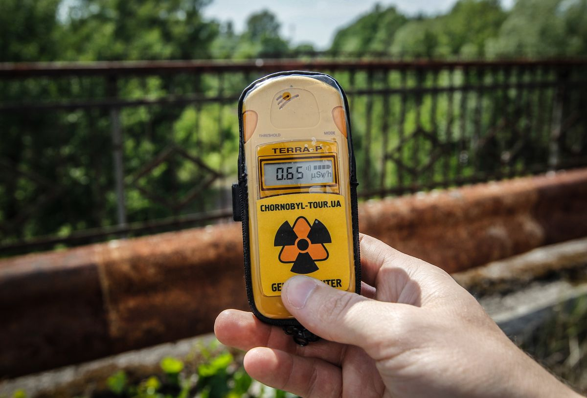 A visitor measures the level of radiation on the so-called Death bridge in the abandoned city of Pripyat, near the Chernobyl nuclear power plant, Ukraine, on 7 June 2019. The Chernobyl Series (HBO) , which depicts the Chernobyl nuclear power disaster's aftermath, including the clean-up operation and subsequent inquiry, drives boom in tourists travelling to see the site of nuclear disaster. Tour agencies have reported up to a 40 per cent increase in bookings since the miniseries aired May 2019. On 2019 Ukraine marked the 33rd anniversary of Chernobyl nuclear disaster. The Chernobyl accident occurred on 26 April 1986 at the Chernobyl Nuclear Power Plant near the city of Pripyat, and regarded the biggest nuclear accident in the history. (Photo by STR/NurPhoto)
