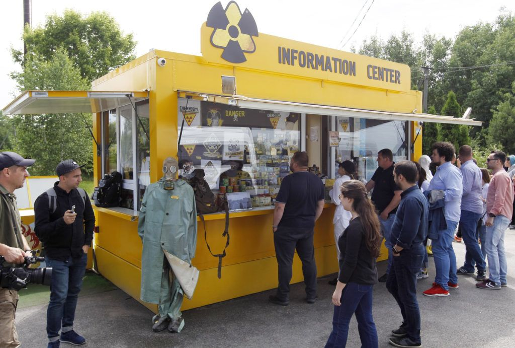 Visitors stand next to a point of tourist information at the Dityatki checkpoint at the entrance to the Chernobyl exclusion zone, Ukraine, on 7 June 2019. The Chernobyl Series (HBO) , which depicts the Chernobyl nuclear power disaster's aftermath, including the clean-up operation and subsequent inquiry, drives boom in tourists travelling to see the site of nuclear disaster. Tour agencies have reported up to a 40 per cent increase in bookings since the miniseries aired May 2019. On 2019 Ukraine marked the 33rd anniversary of Chernobyl nuclear disaster. The Chernobyl accident occurred on 26 April 1986 at the Chernobyl Nuclear Power Plant near the city of Pripyat, and regarded the biggest nuclear accident in the history. (Photo by STR/NurPhoto)