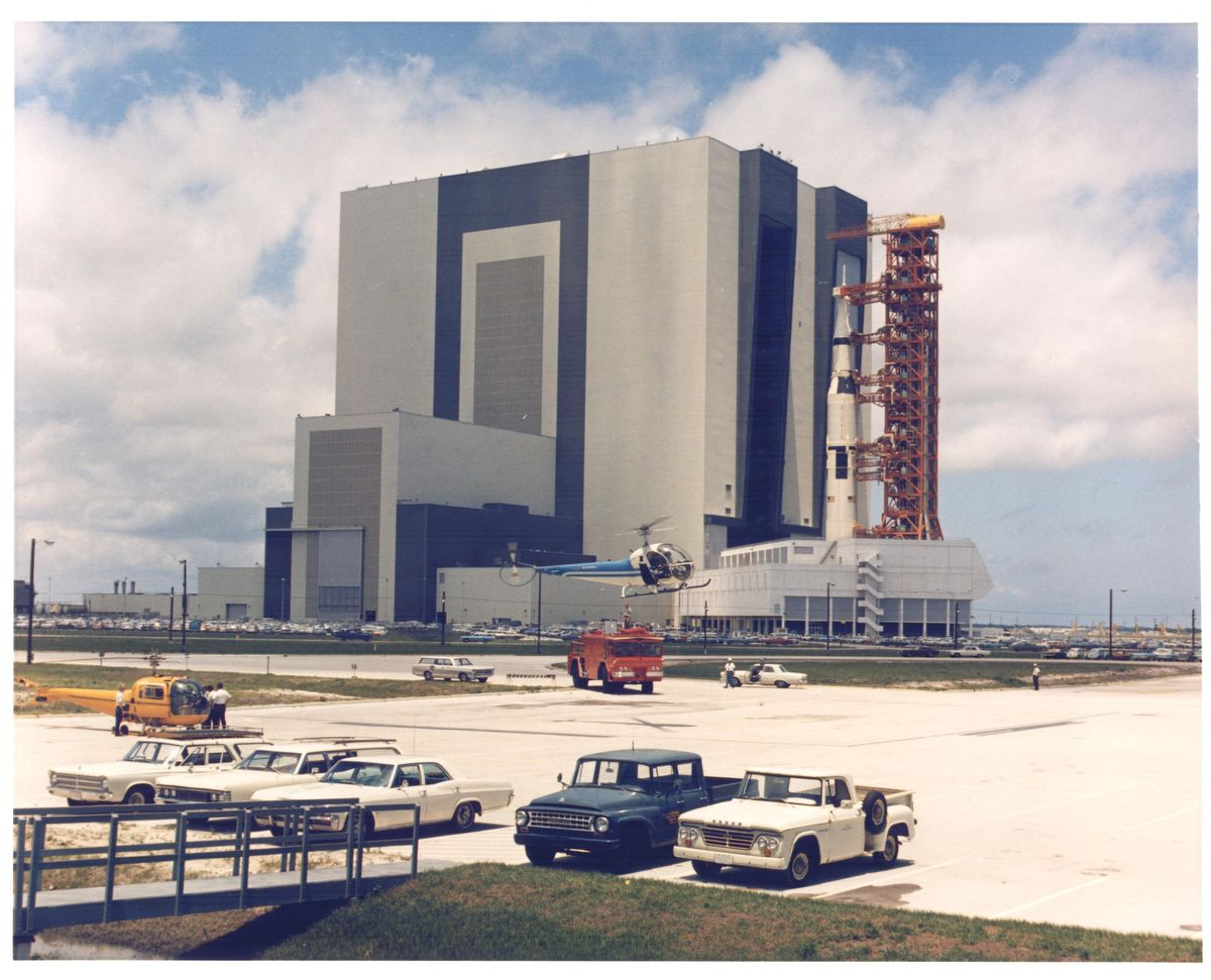 KENNEDY SPACE CENTER, FLA. -  Carrying the Apollo 11 Saturn V space vehicle and mobile launcher, the transporter inches its way to the hardstand atop Launch Complex 39A.  (Unfueled Saturn V weighs 1/2 million pounds,)  Rollout began at 12:30 p.m. EDT today and was completed at 7:46 p.m.  after positioning the 12.5-million-pound load on support pedestals. The transporter carried the vehicle along the 3.5-mile crawlerway at an average speed of less than 1 mile per hour.  The 363-foot-high space vehicle is to launch Apollo 11 astronauts Neil A. Armstrong, Michael Collins and Edwin E. Aldrin Jr. on the Nation's first manned lunar landing mission.