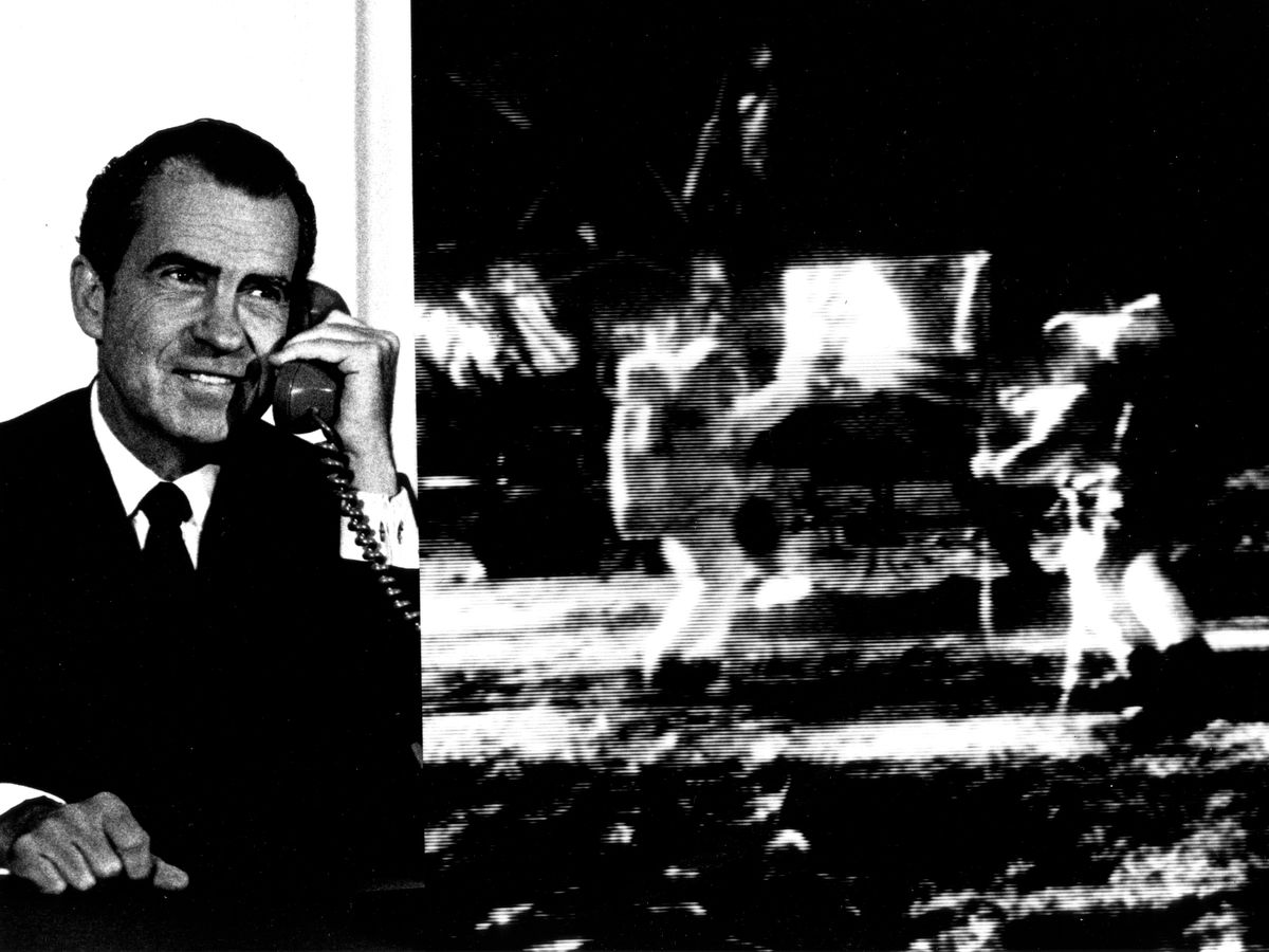 """Composite photo of President Richard M. Nixon as he telephoned """"Tranquility Base"""" and astronauts Neil Armstrong and Edwin """"Buzz"""" Aldrin. The President: """"... For one priceless moment in the history of man, all of the people on this Earth are truly one, one in their pride in what you have done and one in our prayers that you will return safely to Earth."""" Astronaut Armstrong: """"...Thank You, Mr. President. It is a great honor and privilege for us to be here representing not only the United States, but men of peaceable nations, men with an intrest and curiosity, and men with a vision for the future. It is an honor for us to be able to participate here today."""""""