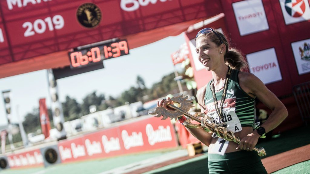 South African long-distance runner Gerda Steyn win the women's race in the 94th edition of the Comrades Marathon between Durban and Pietermaritzburg in 5:58:53 in Pietermaritzburg on June 9, 2019. - The annual ultramarathon spans 86 kilometers, attracting this year over 20,000 runners from around the world. (Photo by Rajesh JANTILAL / AFP)