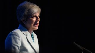 Britain's Prime Minister Theresa May speaks as she addresses attendees at the start of London Tech Week in London on June 10, 2019. - The contest to replace Theresa May as Britain's next leader formally got under way on Monday, with frontrunner Boris Johnson facing criticism from Paris over his Brexit plan and a key rival struggling to throw off a drugs scandal. (Photo by Leon Neal / POOL / AFP)