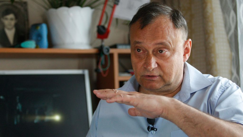 """59-year-old former engineer Oleksiy Ananenko, hailed in the US mini-series """"Chernobyl"""" as one of three men who helped avert an even greater disaster after the worst nuclear accident in history, gestures as he speaks to an AFP journalist during an interview in Kiev on June 7, 2019. - HBO's hugely popular television series """"Chernobyl"""" has renewed interest around the world on Ukraine's 1986 nuclear disaster with authorities reporting a 30% increase of tourist demands to visit the affected area and tourist operators forecasting that number of tourists visiting the site may double this year up to 150.000 persons (Photo by Anatolii STEPANOV / AFP)"""