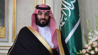 """(FILES) In this file photo taken on November 27, 2018 Saudi Arabia's Crown Prince Mohammed bin Salman is pictured while meeting with the Tunisian President at the presidential palace in Carthage on the eastern outskirts of the capital Tunis. - There is """"credible evidence"""" linking Saudi Arabia's crown prince to the killing of Saudi journalist Jamal Khashoggi last October, an independent UN rights expert said on June 19, 2019, calling for an international investigation. UN special rapporteur on extrajudicial, summary or arbitrary executions said for instance that she had found evidence that """"Khashoggi was himself fully aware of the powers held by the Crown Prince, and fearful of him."""" Khashoggi, a Washington Post contributor and critic of Saudi Crown Prince Mohammed bin Salman, was murdered at the Saudi consulate in Istanbul on October 2. (Photo by FETHI BELAID / AFP)"""