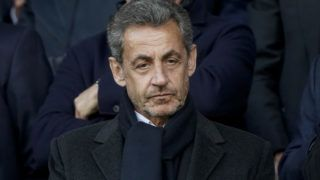 (FILES) In this file photo taken on May 4, 2019, French former President Nicolas Sarkozy is pictured as he attends a football match at the Parc des Princes stadium in Paris. - French Justice dismissed on June 19, 2019 Sarkozy's lawyers last request to cancel corruption charges against him and thus ordered to stand a trial. Sarkozy is accused of attempted, with the help of his lawyer Thierry Herzog, to pervert the course of justice by obtaining inside information from one of the magistrates about the progress of another probe and that he was tipped off that his mobile phone had been tapped by judges looking into the alleged financing of his 2007 election campaign by former Libyan dictator Moamer Kadhafi. (Photo by Lionel BONAVENTURE / AFP)