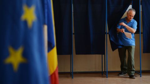 A man steps out of a polling booth after voting for the European Parliament elections on May 25, 2014 at a polling station in Bucharest. AFP PHOTO / DANIEL MIHAILESCU (Photo by DANIEL MIHAILESCU / AFP)
