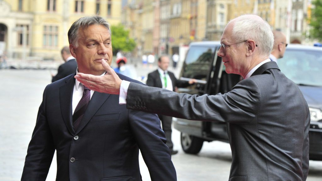 European Council President Herman Van Rompuy (R) welcomes Hungarian Prime Minister Viktor Orban on June 26, 2014 at the Town Hall of Ypres, northwest of Belgium, as European Union leaders met for a ceremony to mark the 100th anniversary of the outbreak of World War I. The ceremony will be followed by an informal dinner to discuss the EU agenda for the next five years and the next Commission president. AFP PHOTO / GEORGES GOBET (Photo by GEORGES GOBET / AFP)